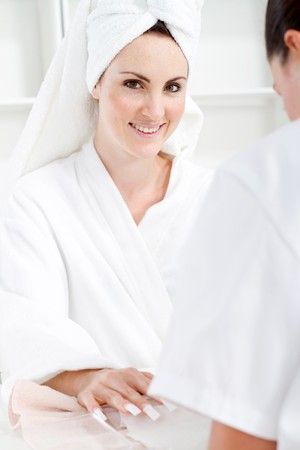 relaxed woman gettting manicure in spa Stock Photo - 7871437