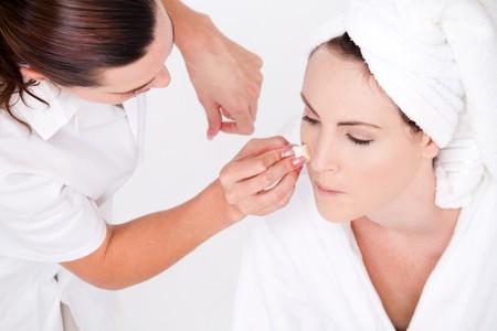 woman having make up done photo