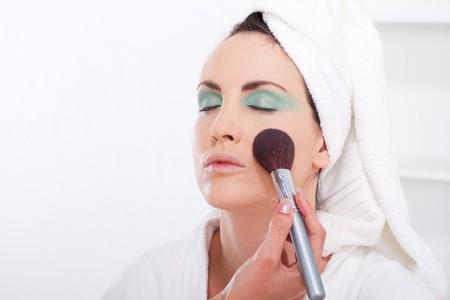 woman applying makeup photo
