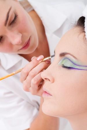 model having eye make up done photo