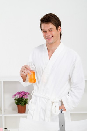 mouthwash: young man using mouthwash