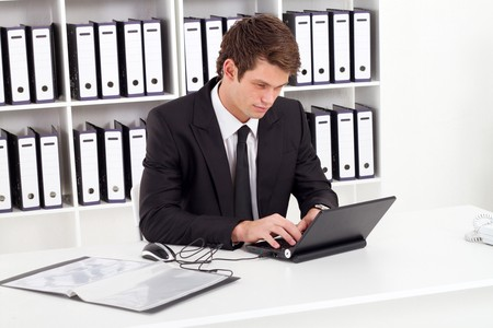 young businessman working at desk photo