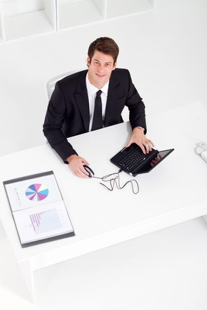overhead of businesswoman working in office photo