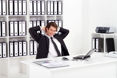 work break: relaxed businessman in office Stock Photo