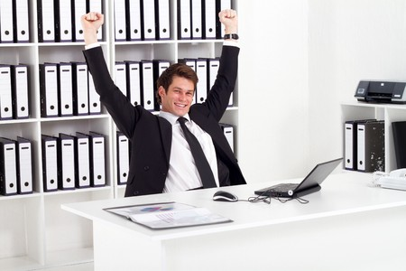 happy businessman in office photo