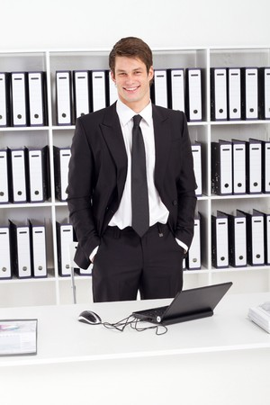 happy young businessman in office photo