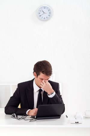 stressed businessman in office photo