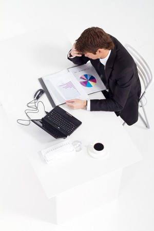 overhead of businessman working at desk Stock Photo - 7881974