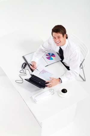 overhead of happy businessman in office photo