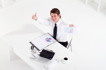 thumbs up businessman holding sales graph photo