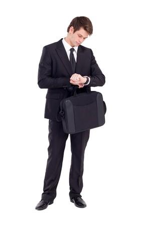 puntualidad: empresario comprobaci�n de reloj sobre blanco  Foto de archivo