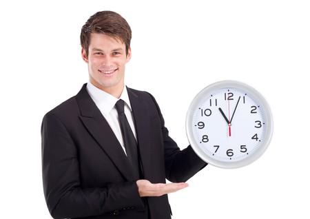 smart businessman holding clock photo