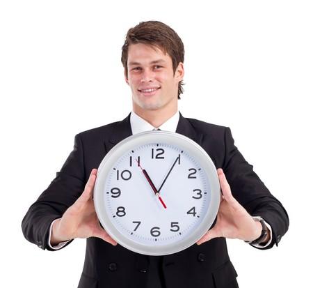 handsome businessman holding clock photo