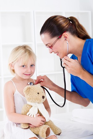 pediatrics: doctor examining little girl