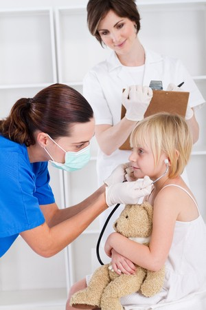 pediatrician giving little girl checkup in hospital Stock Photo - 7940108