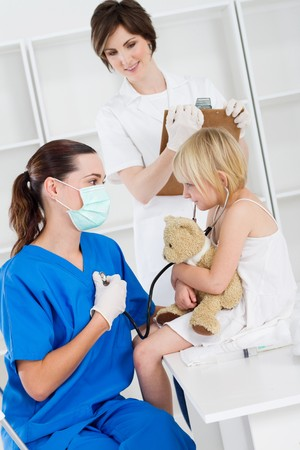 little girl patient listening to doctors heart photo