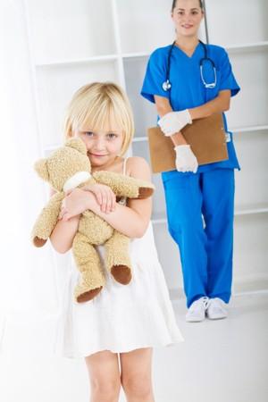 little girl in doctors office photo