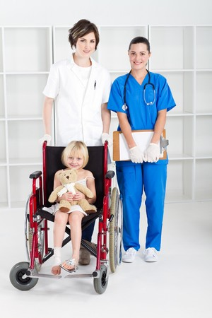 nurse and doctor with little girl in wheelchair photo