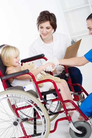 doctor, nurse shake hands with little girl patient Stock Photo - 7940043