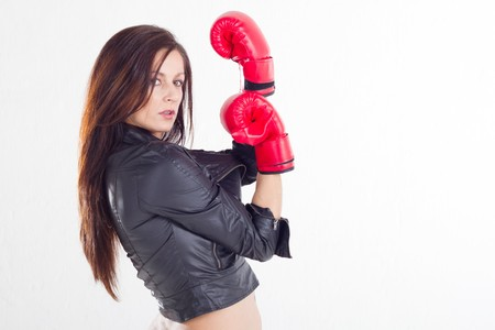 sexy woman wearing boxing gloves photo