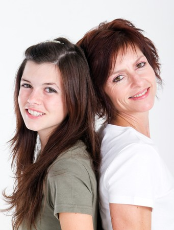 pretty teen daughter and mom back to back photo