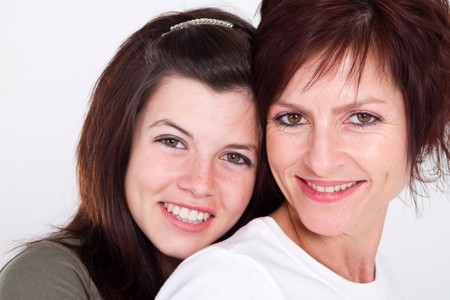 teen aged: loving middle aged mom and teen daughter Stock Photo