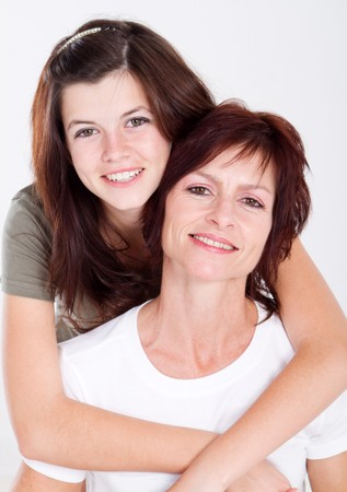 happy teen daughter and middle aged mum photo