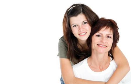 parent and teenager: portrait of european mother and daughter