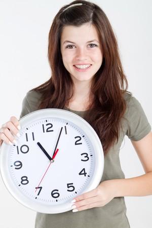 teen beauty holding clock photo