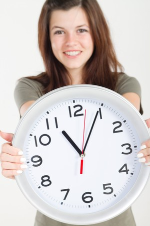 pretty teen girl holding wall clock photo