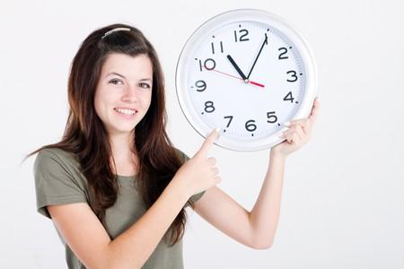 pretty teen girl holding clock photo