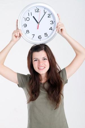 spunky: pretty teen girl holding clock Stock Photo