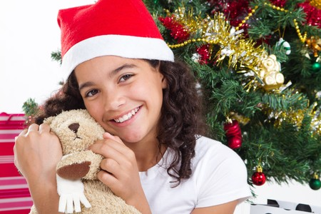 pretty teen colored girl under christmas tree Stock Photo - 8112125