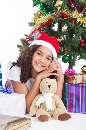gorgeous young indian girl under christmas tree photo