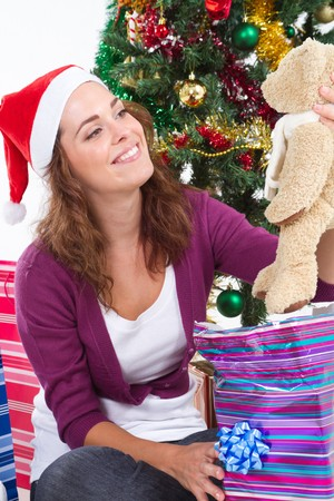 spunky: happy woman opening christmas gifts