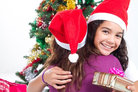 happy daughter hugging mother on christmas day Stock Photo - 8112029