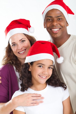 portrait of happy family wearing christmas hats photo