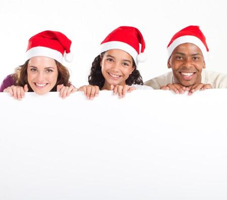 happy christmas family holding whiteboard Stock Photo - 8111812