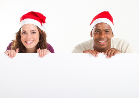 christmas adults holding whiteboard Stock Photo - 8111825