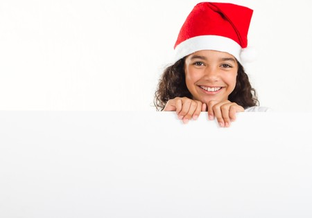 happy teen girl with christmas hat holding whiteboard photo