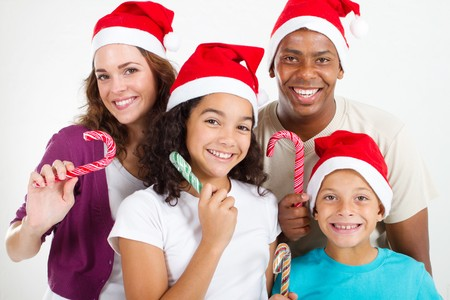 happy christmas family holding candy canes photo