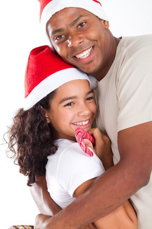 festive african american father and daughter hugging photo