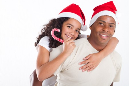 happy christmas father and daughter piggyback photo