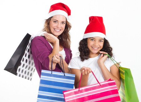 festive mother and daughter doing christmas shopping photo