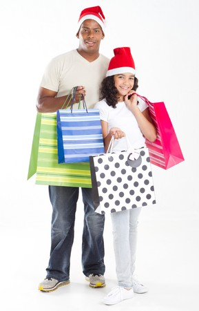happy christmas father and daughter holding gift bags photo