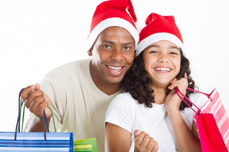 festive father and young daughter holding gifts photo