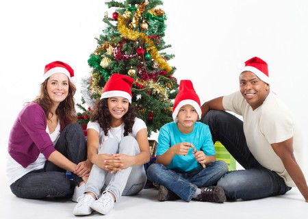 religious clothing: happy young family around christmas tree