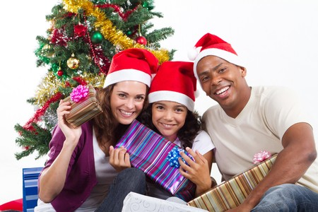 happy young family under christmas tree with gifts Stock Photo - 8112051