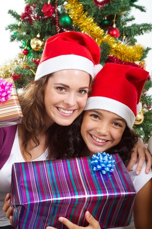happy young mother and daughter on christmas morning photo