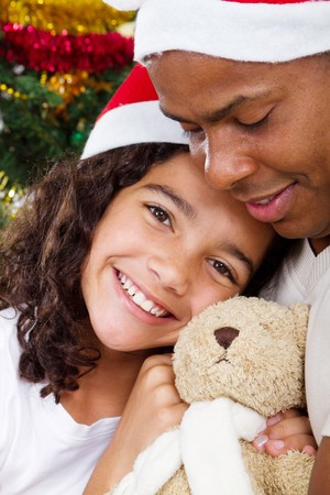 happy father and daughter at christmas time photo